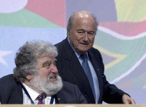 """FIFA President Sepp Blatter (R) walks behind the general-secretary of the Caribbean, North and Central American (CONCACAF) Chuck Blazer, the US official whose claims led to the suspension of Asian football chief Mohamed bin Hammam and Jack Warner of Trinidad andTobago, on June 1, 2011 at the start of the 61st FIFA congress at the Zurich Hallenstadion in Oerlikon near Zurich. Blatter vowed on June to steer FIFA through """"troubled waters"""" ahead of his expected re-election as head of football's corruption-tainted governing body. AFP PHOTO / SEBASTIAN DERUNGS"""