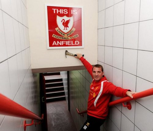 LIVERPOOL, ENGLAND - JULY 09:  (THE SUN OUT,THE SUN ON SUNDAY OUT) Brendan Rodgers manager of Liverpool with the remounted original 'This Is Anfield' Sign at Anfield on July 9, 2012 in Liverpool, England.  (Photo by John Powell/Liverpool FC via Getty Images) *** Local Caption *** Brendan Rodgers