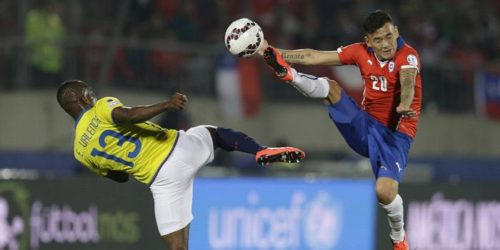 Chile's Charles Aranguiz  and Ecuador's Enner Valencia battle for the ball  during a Copa America Group 1 soccer match at the National Stadium in Santiago, Chile, Thursday, June 11, 2015.(AP Photo/Natacha Pisarenko) Chile Soccer Copa America Chile Ecuador