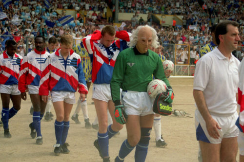 Peterborough United's goalkeeper Fred Barber wears an old man mask as the teams walk out onto the Wembley turf
